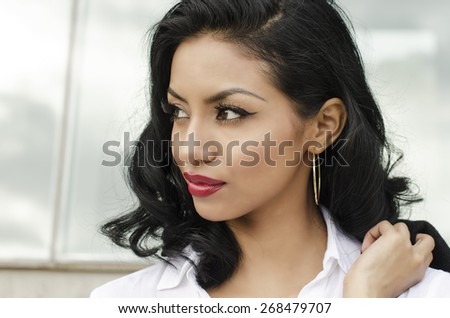 Attractive woman - well dressed - looking to side - stock photo