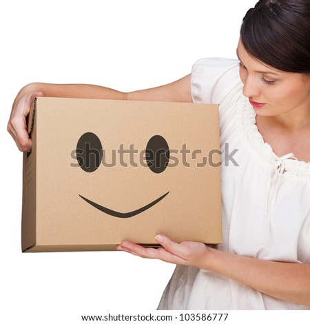 Attractive woman with box making a removal. Smile face illustrated on box. Easy, happy carefree moving concept - stock photo