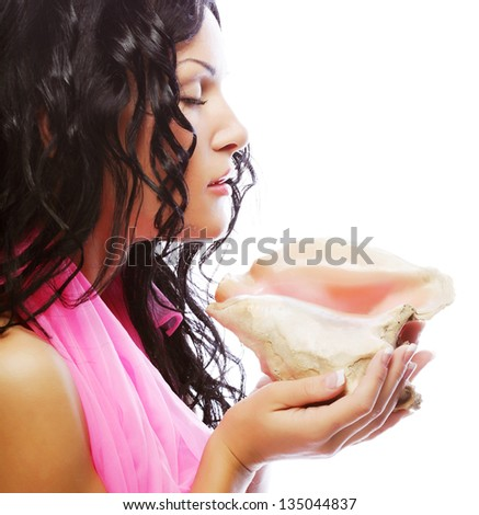 attractive woman with marine shell - stock photo