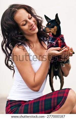 Attractive woman with non-allergic dog Zwergpinscher - stock photo