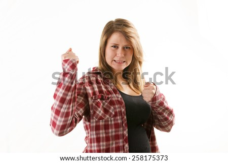 Attractive woman with red plaid shirt being feisty. - stock photo