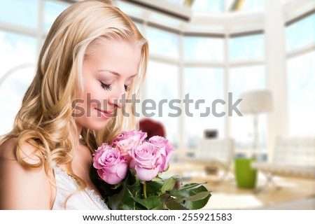 attractive woman with roses - stock photo