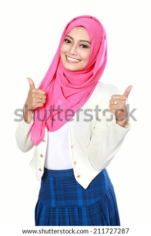 attractive woman with scarf showing thumbs up - stock photo