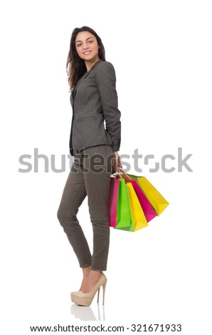 Attractive woman with shopping bags isolated on white - stock photo