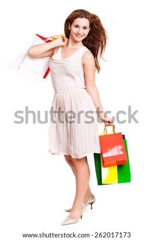 attractive woman with shopping bags on isolated background - stock photo