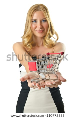 Attractive woman with shopping cart - stock photo