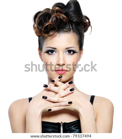 Attractive  woman with stylish hairstyle and black nails. Fashion eye make-up - stock photo