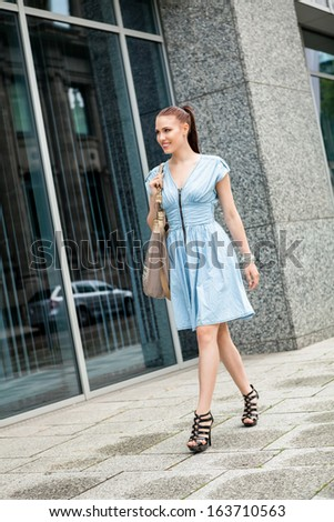 attractive woman with sunglasses in the city summertime portrait lifestyle smiling - stock photo