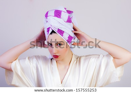 attractive woman with towel on head - stock photo