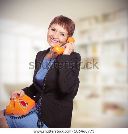 attractive woman  with vintage telephone - stock photo