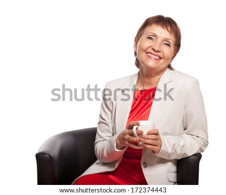 attractive woman 50 years old with white cup isolated on white background - stock photo