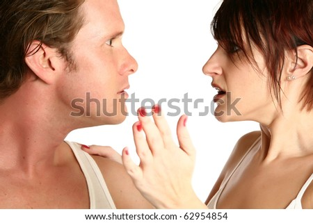 Attractive 35 year old couple fighting over white background. Motion blur on woman's hand. - stock photo