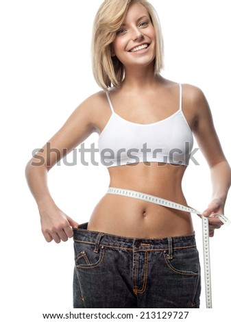 attractive yong caucasian woman isolated  on white background studio shot figure body jeans - stock photo