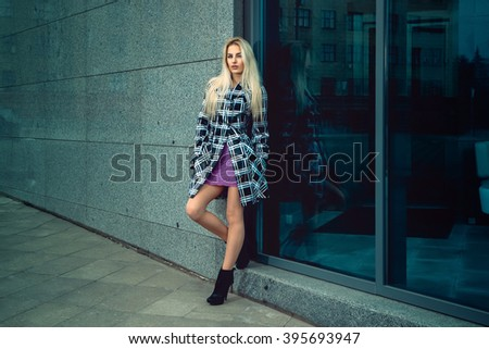 Attractive young adult blonde fashion model posing outdoors. fashion model posing outdoors. fashionable and glamour concept. - stock photo