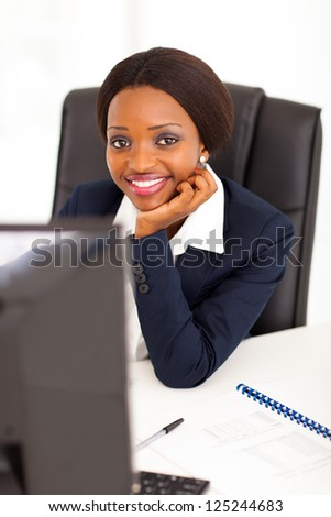 attractive young african american corporate worker in office - stock photo