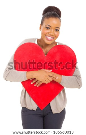 attractive young african woman hugging red heart shape - stock photo