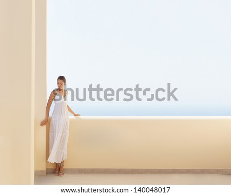 Attractive, young and healthy girl at the resort. Image has a lot of space to put any text. - stock photo
