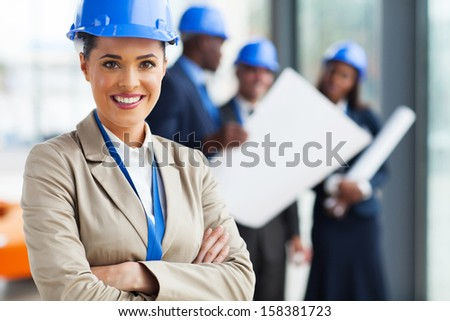 attractive young architect with arms crossed  - stock photo