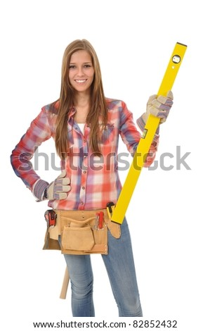 Attractive young artisan holds a spirit level - stock photo