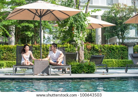 Attractive Young Asian Couple at a resort - stock photo