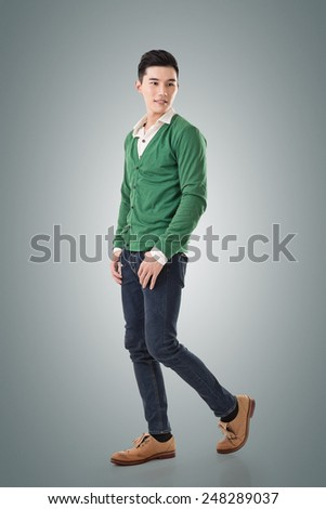 Attractive young Asian man, full length portrait isolated on white background. - stock photo
