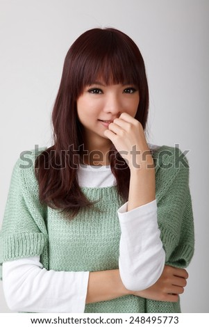 Attractive young asian woman, closeup portrait. - stock photo