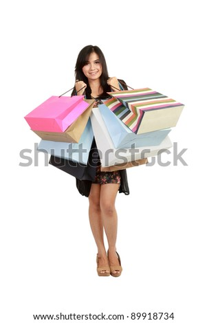 Attractive Young beautiful asian Woman with Shopping Bags in white background - stock photo