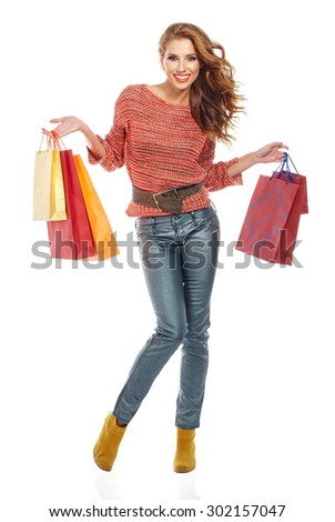 Attractive Young beautiful brunette Woman with Shopping Bags - stock photo