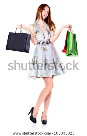 Attractive young beautiful woman with shopping bags over white background. - stock photo