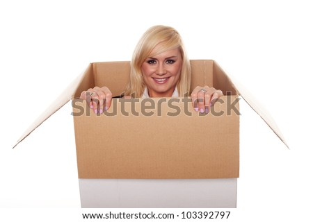 Attractive young blonde emerging from a box isolated on white - stock photo