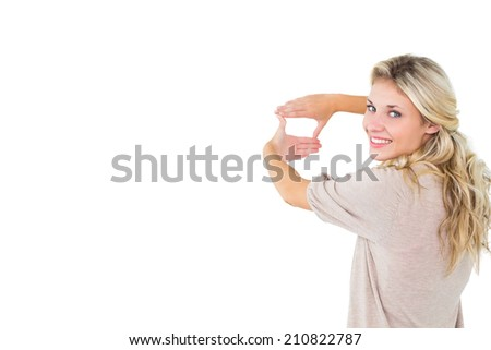 Attractive young blonde framing with her hands on white background - stock photo