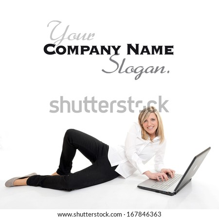 Attractive young blonde using a laptop on the floor  - stock photo