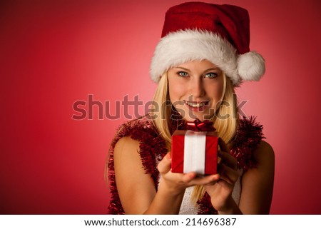 Attractive young blonde woman in santa claus dress - stock photo