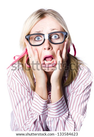 Attractive young blonde woman wearing nerdy glasses reacting in horror and fright with her eyes wide and her hands clawing at her face while her bottom lips juts out in a quiver, isolated portrait - stock photo
