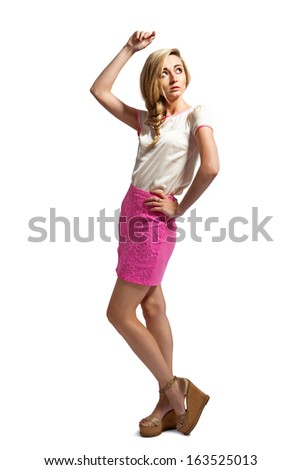 attractive young blonde woman with pink skirt isolated fashion posing  - stock photo