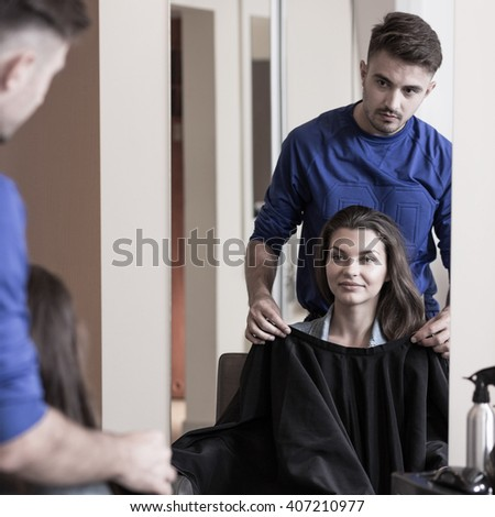 Attractive young brunette girl at the hairdresser's - stock photo
