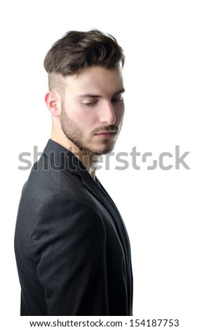 Attractive young business man looking down, serious expression, isolated on white - stock photo