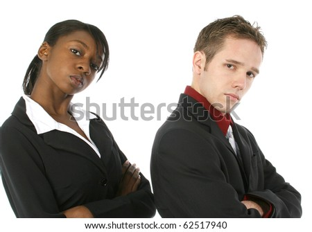 Attractive young business team with serious expressions over white background.  Male and female. - stock photo
