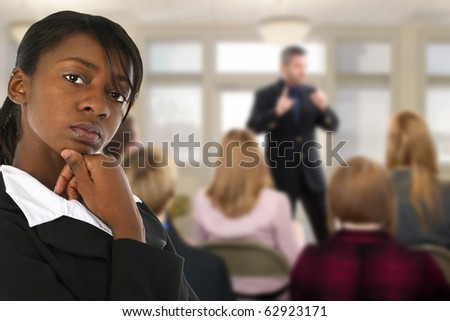 Attractive young business woman at conference meeting. - stock photo