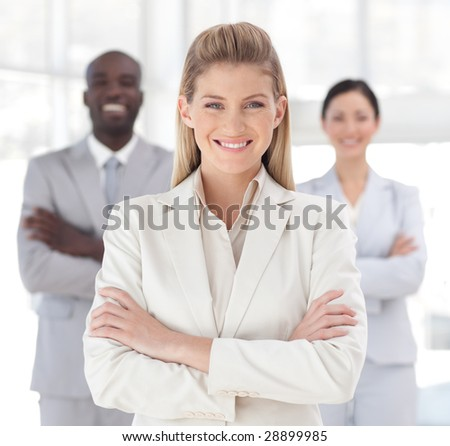 Attractive Young Business woman smiling at camera - stock photo