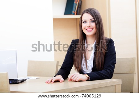 Attractive young business woman using laptop - stock photo