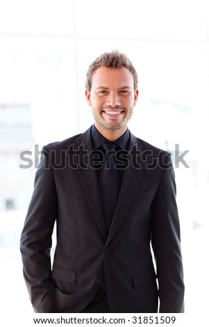 Attractive young businessman smiling at the camera - stock photo