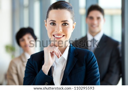 attractive young businesswoman and colleagues - stock photo
