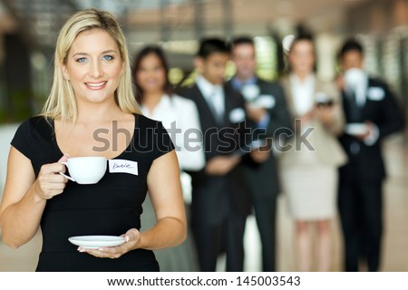 attractive young businesswoman coffee break during conference - stock photo