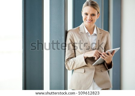 attractive young businesswoman holding tablet computer - stock photo