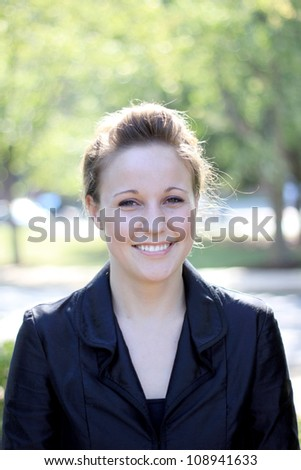 Attractive Young Businesswoman Smiling - stock photo