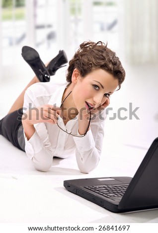 Attractive young businesswoman with notebook - stock photo