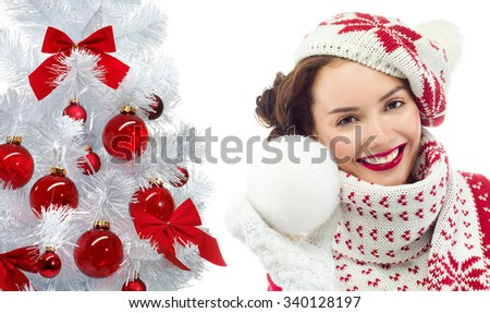 attractive young caucasian woman in warm clothing  in studio isolated on white smiling christmas new year tree - stock photo