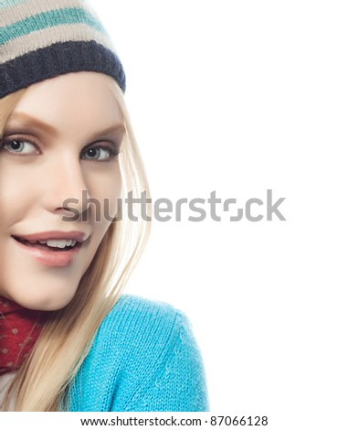 attractive young caucasian woman in warm colorful clothing  with yellow leaf studio shot isolated on white - stock photo