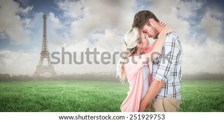 Attractive young couple about to kiss against eiffel tower - stock photo